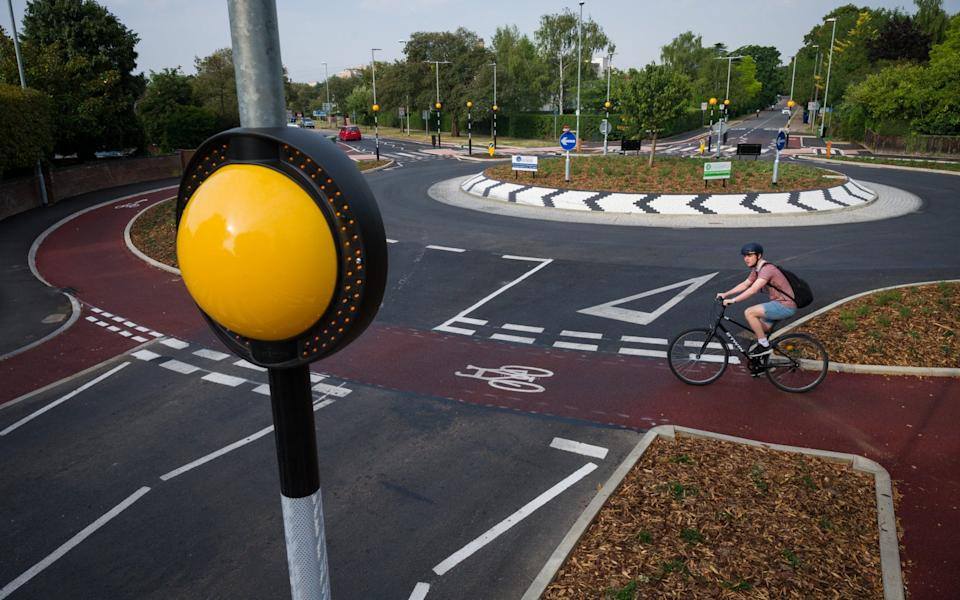 It provides an outer ring for cyclists and zebra crossings for pedestrians, requiring motorists to yield to both before entering - Leon Neal/Getty Images Europe