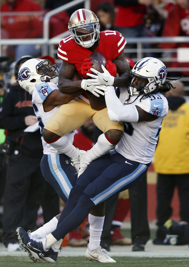 <p>San Francisco 49ers wide receiver Marquise Goodwin, center, makes a catch between Tennessee Titans linebacker Erik Walden, left, and cornerback Adoree' Jackson, right during the first half of an NFL football game Sunday, Dec. 17, 2017, in Santa Clara, Calif. (AP Photo/D. Ross Cameron) </p>