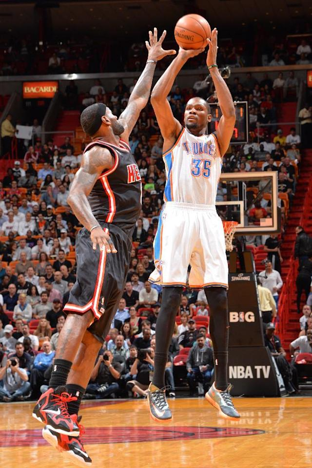 MIAMI, FL - JANUARY 29: Kevin Durant #35 of the Oklahoma City Thunder shoots the ball against the Miami Heat at the American Airlines Arena in Miami, Florida on Jan. 29, 2014. (Photo by Jesse D. Garrabrant/NBAE via Getty Images)