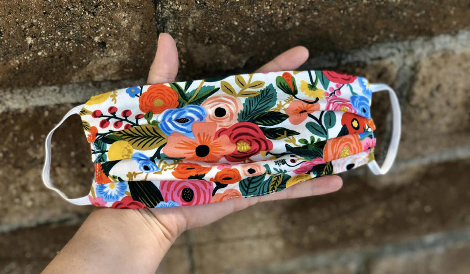 This cheery mask by seller PapillonTails is double-layered and comes in bright colors and prints. (Photo: Etsy)