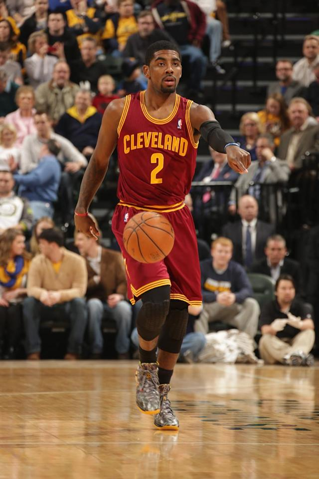 INDIANAPOLIS - DECEMBER 31: Kyrie Irving #2 of the Cleveland Cavaliers dribbles the ball up the court against the Indiana Pacers at Bankers Life Fieldhouse on December 28, 2013 in Indianapolis, Indiana. (Photo by Ron Hoskins/NBAE via Getty Images)