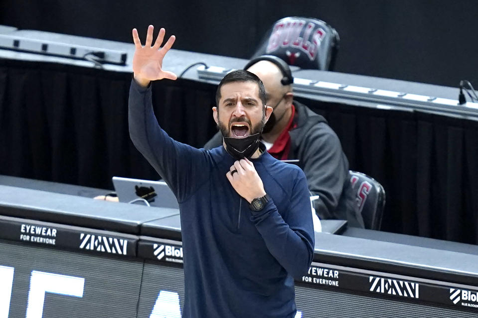 Charlotte Hornets head coach James Borrego yells at his team during the first half of an NBA basketball game against the Chicago Bulls, Thursday, April 22, 2021, in Chicago. (AP Photo/Charles Rex Arbogast)