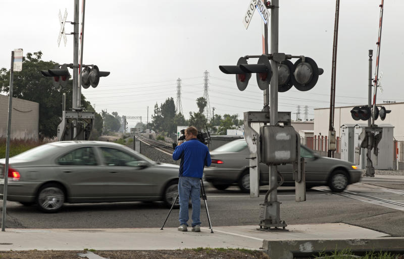 A television cameraman tapes the traffic crossing in the San Gabriel area of Los Angeles Monday, June 11, 2012, where the U.S. Commerce Department Secretary John Bryson suffered a traffic accident Saturday June 9. Officials on Monday said U.S. Commerce Secretary Bryson had suffered a seizure in connection with two Los Angeles-area traffic crashes that led to a felony hit-and-run citation. (AP Photo/Damian Dovarganes)