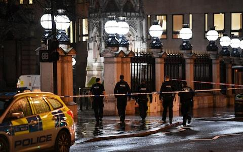 Police officers walk towards Charing Cross station after it was shut due to a gas leak - Credit: DYLAN MARTINEZ/Reuters