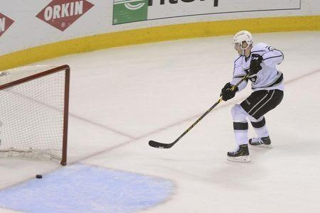 Apr 30, 2014; San Jose, CA, USA; Los Angeles Kings right wing Dustin Brown (23) scores an empty net goal against the San Jose Sharks during the third period in game seven of the first round of the 2014 Stanley Cup Playoffs at SAP Center at San Jose. Kyle Terada-USA TODAY Sports