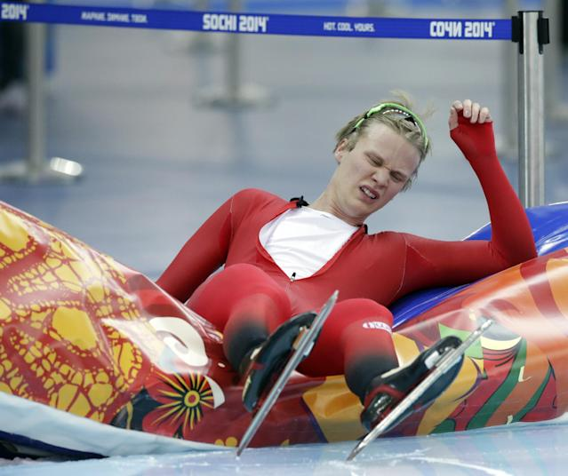Havard Lorentzen of Norway collapses after competing in the men's speedskating team pursuit quarterfinals at the Adler Arena Skating Center during the 2014 Winter Olympics in Sochi, Russia, Friday, Feb. 21, 2014. (AP Photo/Matt Dunham)