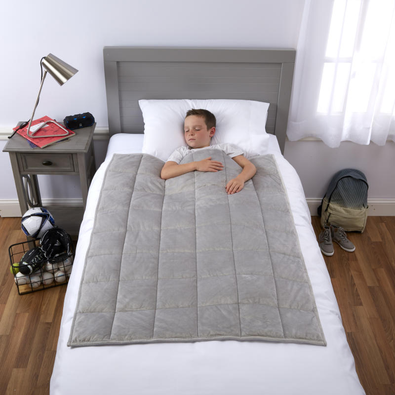 Restless sleeper? A kid-size weighted blanket might be the answer. (Photo: Walmart)