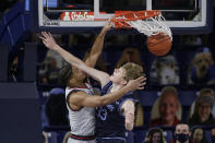 Gonzaga guard Aaron Cook, left, dunks over San Diego forward Ben Pyle during the second half of an NCAA college basketball game in Spokane, Wash., Saturday, Feb. 20, 2021. (AP Photo/Young Kwak)