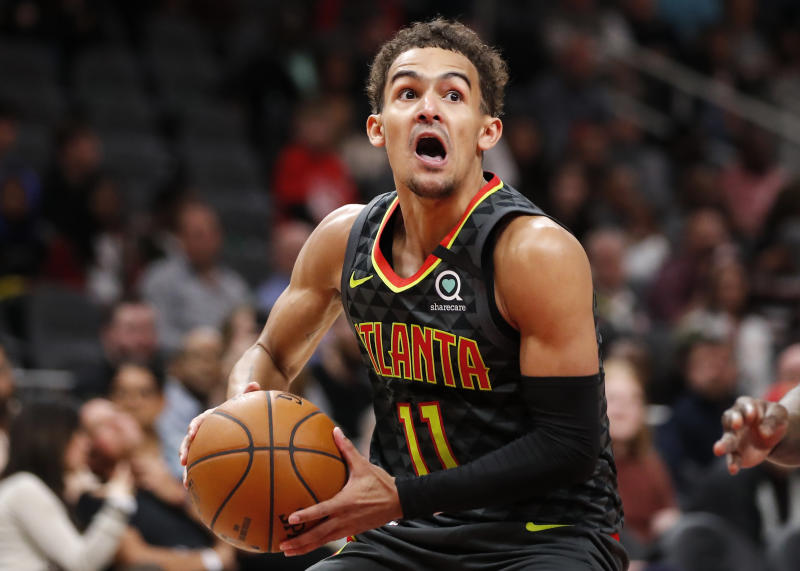 Trae Young is an offensive wunderkind, so what gives in Atlanta? (Todd Kirkland/Getty Images)