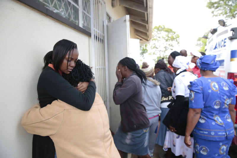 People react after hearing news about their relatives, after a bus crash in Rusape about 170 kilometres east of the capital Harare, Thursday, Nov. 8, 2018. A head-on collision between two buses has killed 47 people, where road accidents are common due to poor roads and bad driving. (AP Photo/Tsvangirayi Mukwazhi)