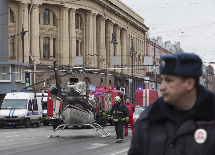 <p>Emergency services personnel stand next to a helicopter outside Tekhnologicheskiy institut metro station in St. Petersburg, Russia, April 3, 2017. A least 10 people were killed Monday in an explosion on the subway in St. Petersburg, Russian news agencies reported. (Russlan Shamukov/Reuters) </p>
