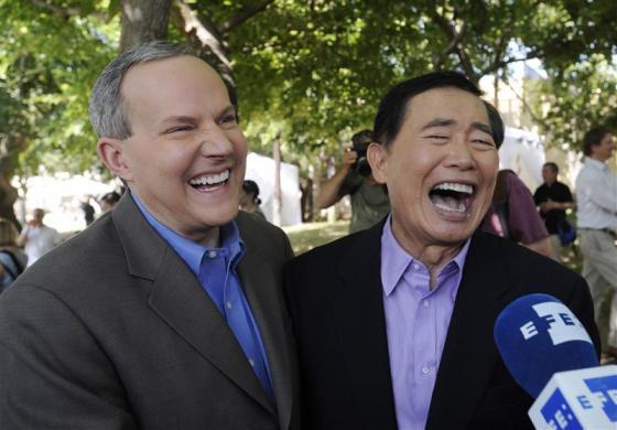 Actor George Takei (R) and partner Brad Altman are interviewed after applying for a marriage license in West Hollywood, California, June 17, 2008.