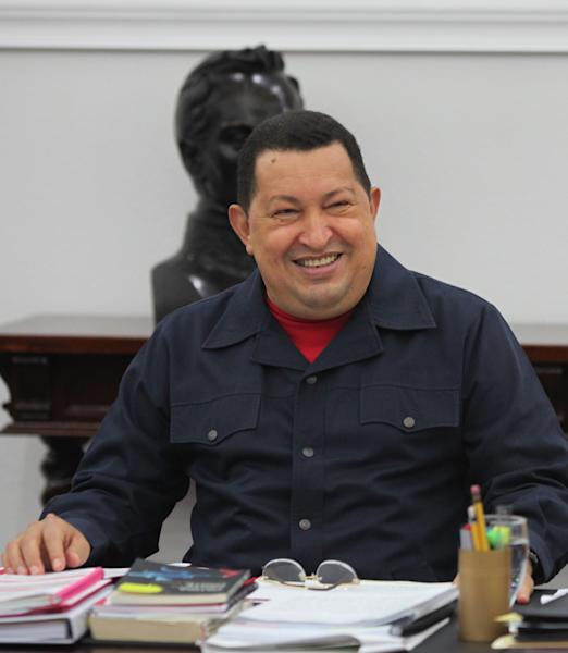 In this photo released by Miraflores Press Office, Venezuela's President Hugo Chavez smiles as he leads a televised Cabinet meeting at Miraflores presidential palace in Caracas, Venezuela, Tuesday, May 22, 2012. Chavez has reappeared on television a week and a half after returning from cancer treatment in Cuba. (AP Photo/Miraflores Press Office, Marcelo Garcia)