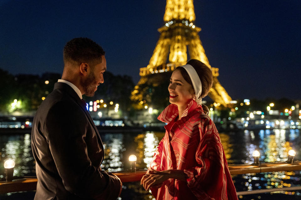 Emily in Paris. (L to R) Lucien Laviscount as Alfie, Lily Collins as Emily in episode 205 of Emily in Paris. Cr. Stéphanie Branchu/Netflix © 2021