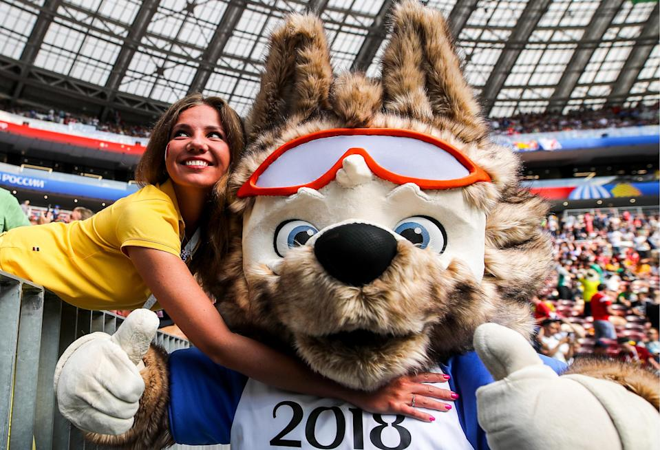 <p>A football fan with a costumed character of the official Russia 2018 mascot, Zabivaka the Wolf, during a First Stage Group C football match between Denmark and France at Luzhniki Stadium at FIFA World Cup Russia 2018; the teams drew 0-0. Sergei Bobylev/TASS (Photo by Sergei Bobylev\TASS via Getty Images) </p>