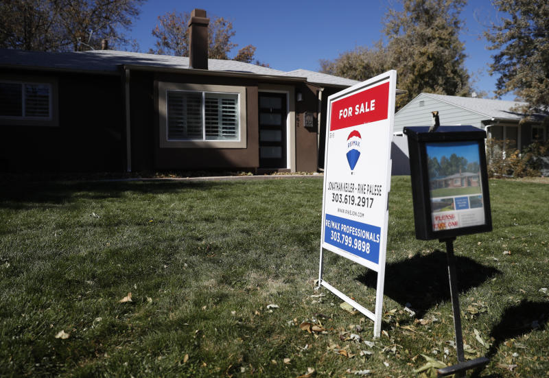 FILE - In this Oct. 22, 2019, file photo a sign stands outside a home for sale in southeast Denver. On Wednesday, Nov. 27, Freddie Mac reports on this week's average U.S. mortgage rates. (AP Photo/David Zalubowski, File)