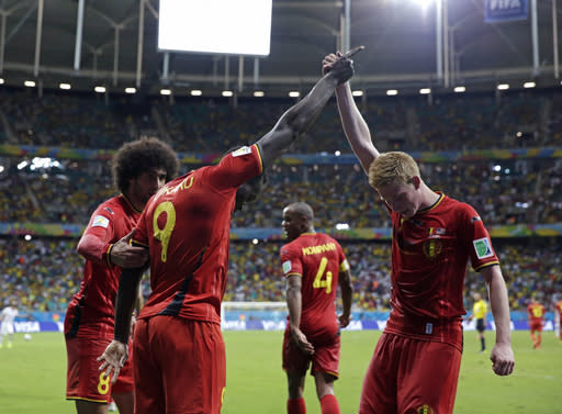 Belgium's Romelu Lukaku, left, celebrates with Kevin De Bruyne after scoring his side's second goal during the World Cup round of 16 soccer match between Belgium and the USA at the Arena Fonte Nova in Salvador, Brazil, Tuesday, July 1, 2014. (AP Photo/Matt Dunham)