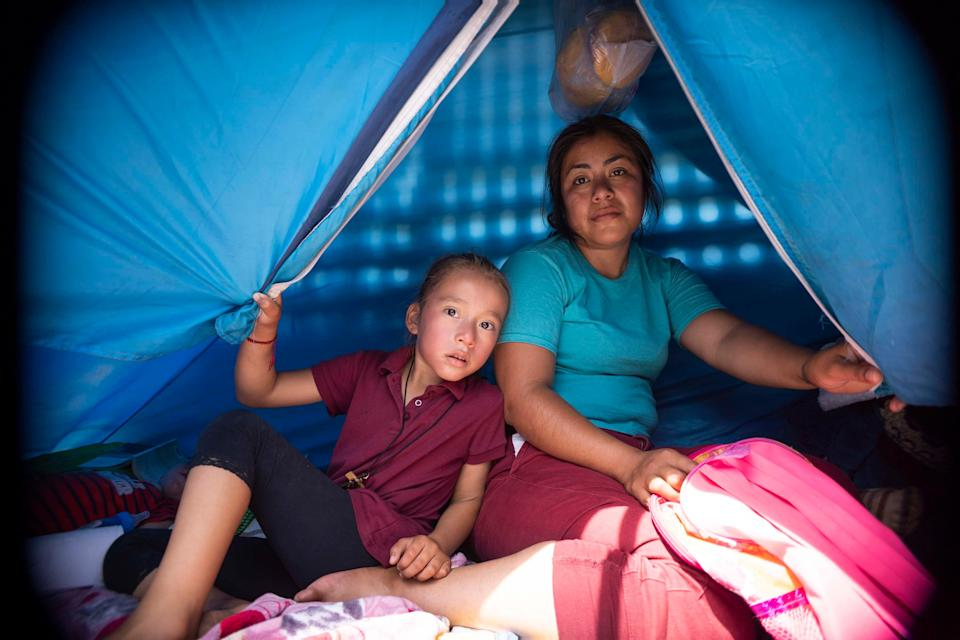 Asylum-seeking families with their children have stayed in tents while waiting for their names to be called at the border in San Luis Rio Colorado, Mexico.