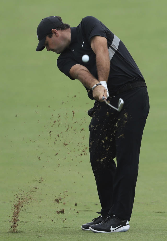 Patrick Reed of the U.S. plays a shot on the first hole during the first round of the DP World Tour Championship golf tournament in Dubai, United Arab Emirates, Thursday, Nov. 21, 2019. (AP Photo/Kamran Jebreili)