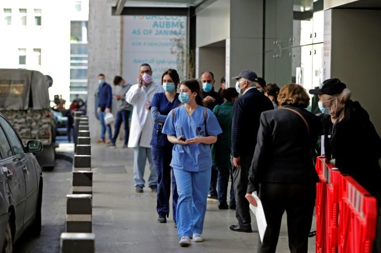 Medical staff are pictured outside AUBMC (American University of Beirut Medical Centre) in the Lebanese capital Beirut on March 17, 2021