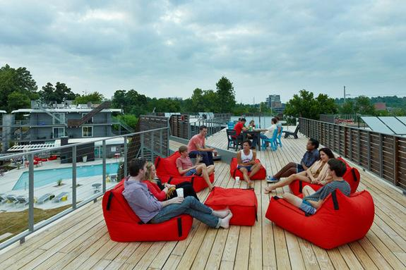 """Views of the public roof deck at the apartment complex. The public roof deck provides the entire tenant community with an elevated space affording interior site views to the """"eco courtyard"""" as well as views of the University of Arkansas, downto"""