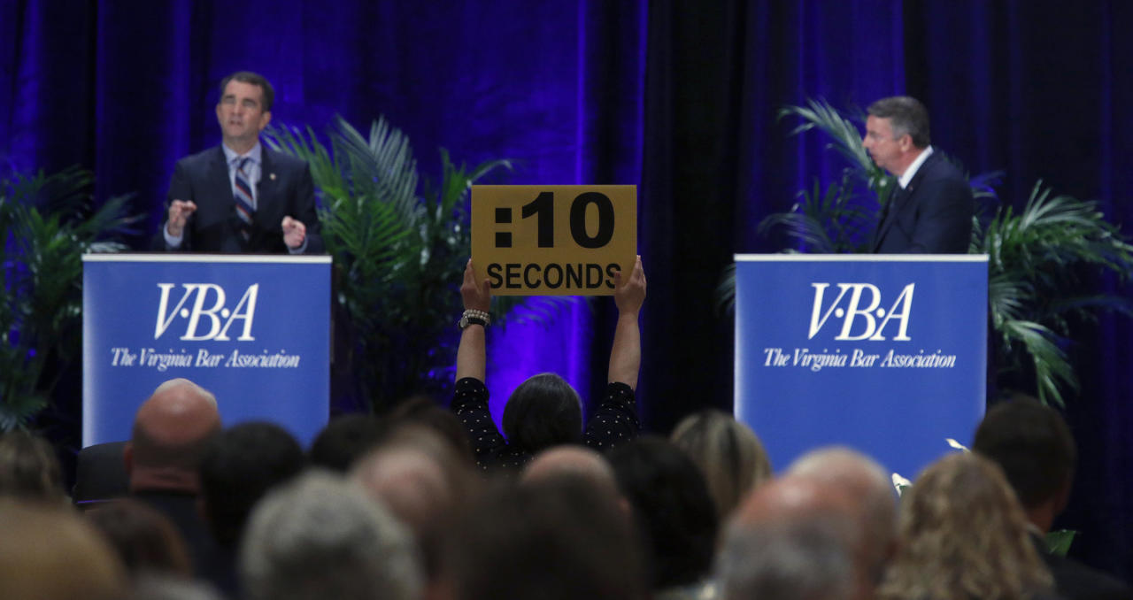 The timer signals 10 seconds left for an answer from Democratic gubernatorial candidate Lt. Gov. Ralph Northam, left, and GOP gubernatorial candidate Ed Gillespie,right, at the Omni Homestead Resort in Hot Springs, Va., Saturday, July 22, 2017. The two major party candidates in Virginia's closely watched race for governor clashed at their first debate over President Donald Trump, health care, immigration, and social issues. ( Bob Brown/Richmond Times-Dispatch via AP)