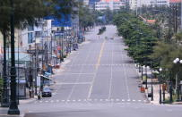 A deserted street is blocked during a virus lockdown in Vung Tau, Vietnam on Sept. 13, 2021. More than a half of Vietnam is under a lockdown order to contain its worst virus outbreak yet. (AP Photo/Hau Dinh)