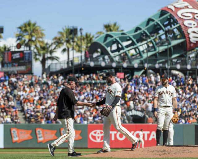 San Francisco Giants relief pitcher Hunter Strickland, right, is relieved by manager Bruce Bochy in the third inning of a baseball game against the Los Angeles Dodgers in San Francisco, Sunday, Sept. 30, 2018. (AP Photo/John Hefti)