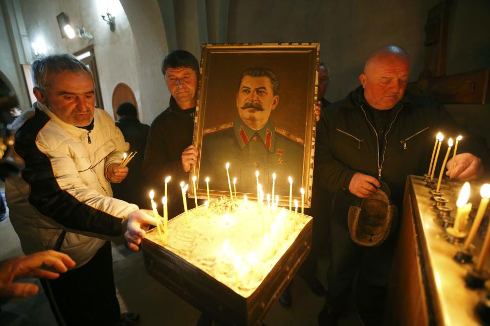 People place candles inside a church during a gathering to mark the anniversary of Soviet leader Joseph Stalin's death in his hometown of Gori, Georgia, March 5, 2017. REUTERS/David Mdzinarishvili