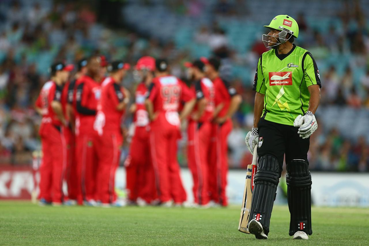 SYDNEY, AUSTRALIA - DECEMBER 14:  Usman Khawaja of the Thunder leaves the field after being dismissed during the Big Bash League match between the Sydney Thunder and the Melbourne Renegades at ANZ Stadium on December 14, 2012 in Sydney, Australia.  (Photo by Mark Kolbe/Getty Images)