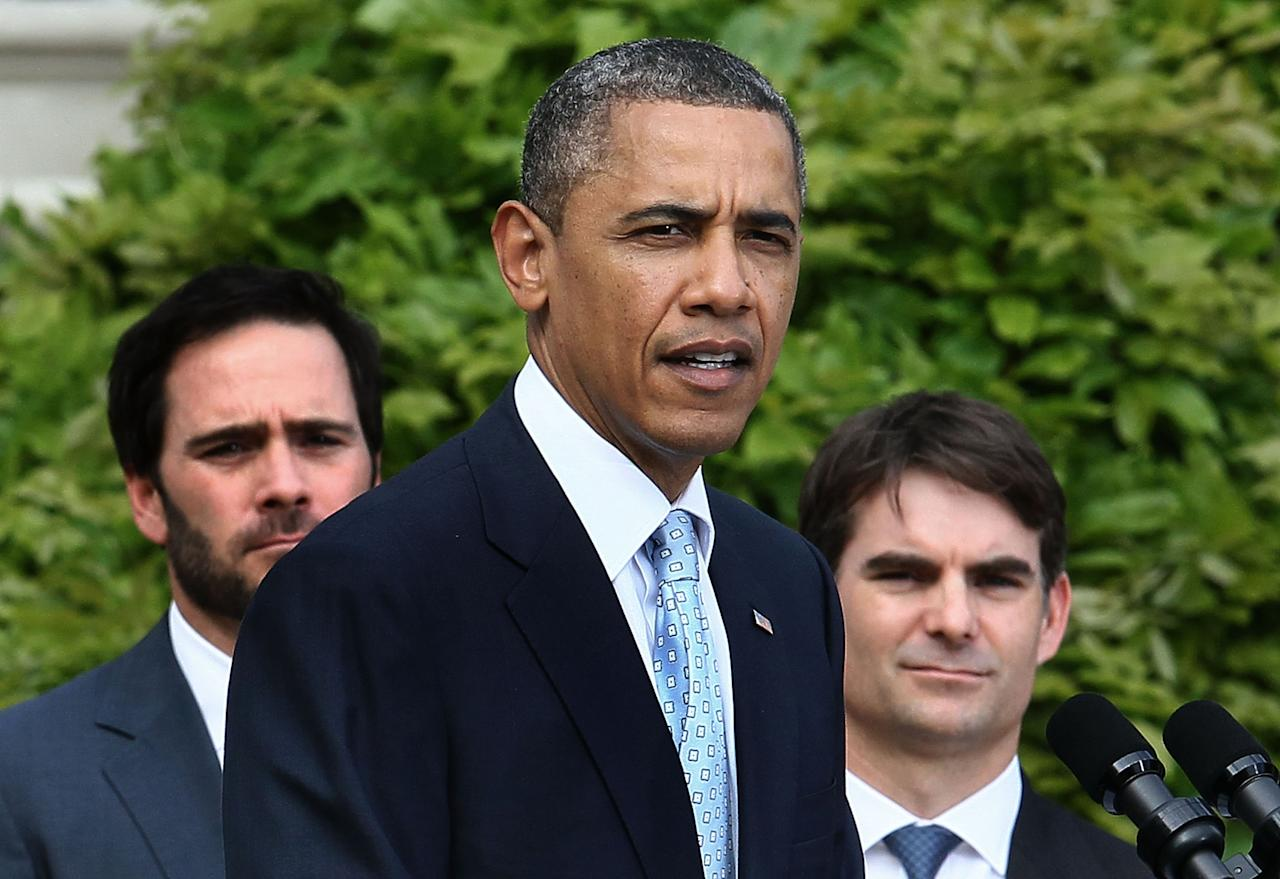 WASHINGTON, DC - APRIL 17:  U.S. President Barack Obama (C), speaks while flanked by, NASCAR drivers Jimmy Johnson (L) and Jeff Gordon during an event on the South Lawn, April 17, 2012 at the White House in Washington, DC. President Obama hosted the event to honor 2011 NASCAR Sprint Cup Series Champion Tony Stewart for his championship season.  (Photo by Mark Wilson/Getty Images)