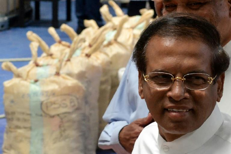Sri Lankan president Maithripala Sirisena walks past seized cocaine in Colombo on April 1, 2019. Sirisena has called for the restoration of the death penalty for serious drug crimes