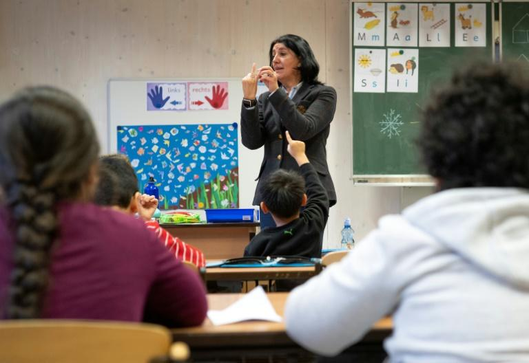 Head teacher Petra Revay-Schwarz says being separated could pose a barrier to learning (AFP Photo/JOE KLAMAR)