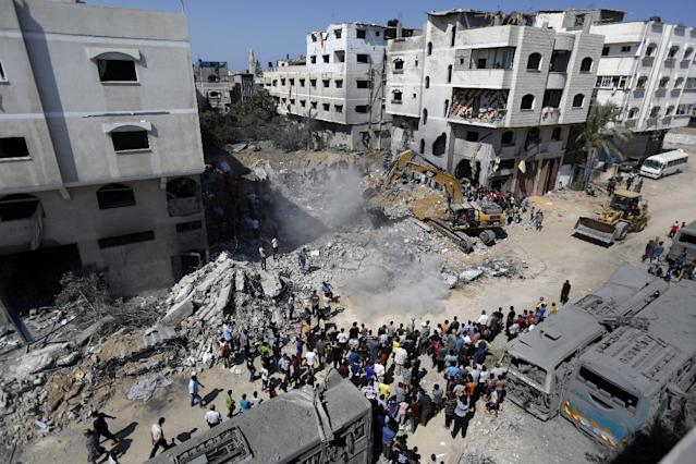 A digger removes debris on August 20, 2014 from a building in Gaza City's Sheikh Radwan neighbourhood destroyed the night before in an Israeli air strike which killed the wife and infant daughter of elusive Hamas military chief Mohammed Deif (AFP Photo/Mohamed Abed)