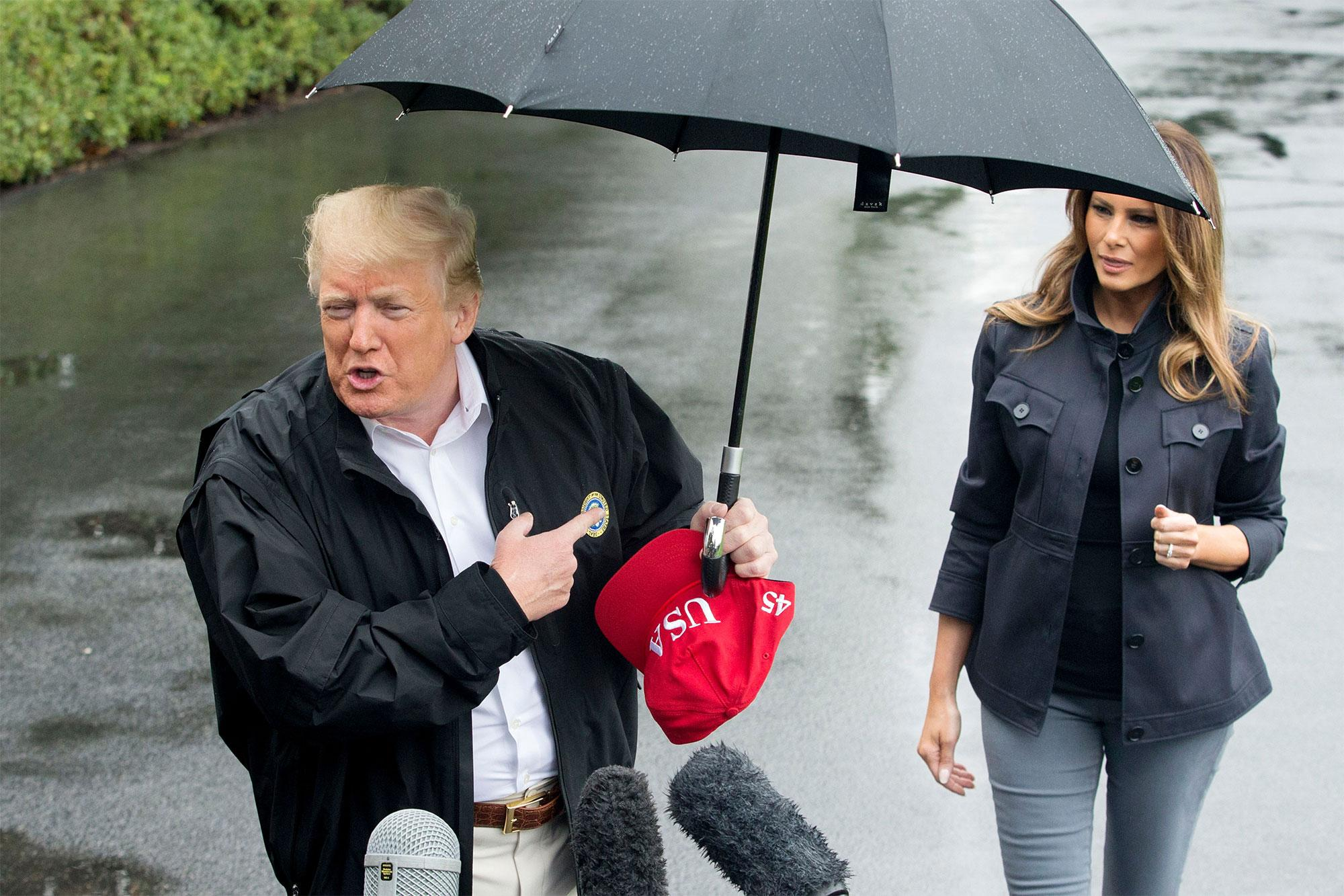 Donald Trump Leaves Wife Melania Out in the Rain While He Uses an Umbrella — See the Photos