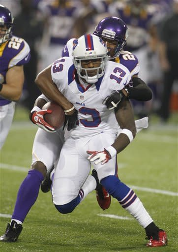 Buffalo Bills wide receiver Steve Johnson (13) is tackled by Minnesota Vikings defensive back Chris Cook (20) in the first half of a preseason football game Friday, Aug. 17, 2012 in Minneapolis. (AP Photo/Andy King)