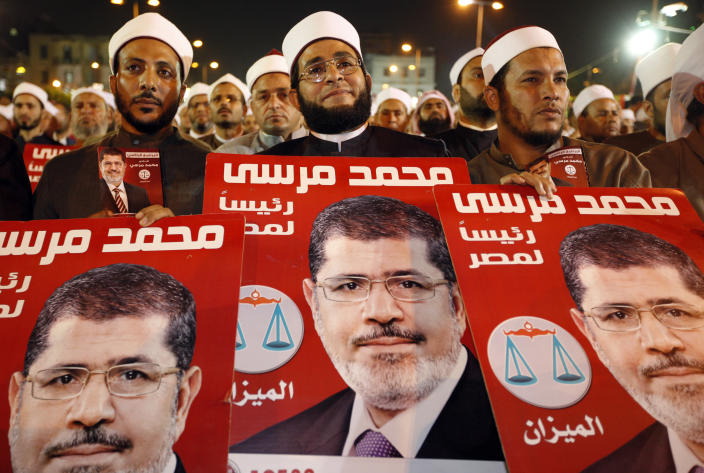 Several hundreds Imams listen to Muslim Brotherhood's presidential candidate Mohammed Morsi at a rally in Cairo, Egypt, Sunday, May 20, 2012. Egypt's election commission is vowing that next week's presidential election will be free and fair. The May 23-24 presidential election is the first since last year's ouster of longtime authoritarian ruler Hosni Mubarak. It marks the first time Egyptians will choose their leader in a race overseen by international monitors. (AP Photo/Fredrik Persson)