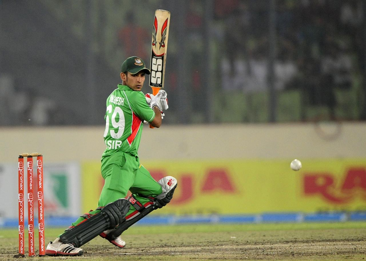 Bangladeshi batsman Nasir Hossain plays a shot during the one day international (ODI) Asia Cup cricket final match between Bangladesh and Pakistan at The Sher-e-Bangla National Cricket Stadium in Dhaka on March 22, 2012. AFP PHOTO/Munir uz ZAMAN (Photo credit should read MUNIR UZ ZAMAN/AFP/Getty Images)