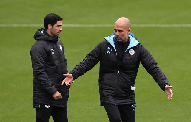 Arteta (left) has been working under Pep Guardiola since retiring from playing (Barrington Coombs/PA)