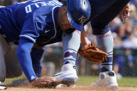 Kansas City Royals' Whit Merrifield, left, steals third base against Chicago Cubs third baseman Patrick Wisdom in the eighth inning of a baseball game Friday, Aug. 20, 2021, in Chicago. (AP Photo/Nam Y. Huh)