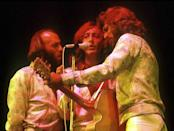 """<p>With so many recent hits, the Bee Gees were the natural choice to score the soundtrack for <u></u>""""Saturday Night Fever"""" (1977). The record earned a Grammy for album of the year and would eventually sell 40 million copies, becoming the best-selling soundtrack in history until Michael Jackson's <u>Thriller</u>. The <a href=""""https://www.amazon.com/Saturday-Night-Fever-2-LP/dp/B01N5M0897/?tag=syn-yahoo-20&ascsubtag=%5Bartid%7C10063.g.35225069%5Bsrc%7Cyahoo-us"""" rel=""""nofollow noopener"""" target=""""_blank"""" data-ylk=""""slk:album's"""" class=""""link rapid-noclick-resp"""">album's </a>three #1 hits included """"How Deep is Your Love,"""" """"Stayin' Alive,"""" and """"Night Fever.""""</p>"""