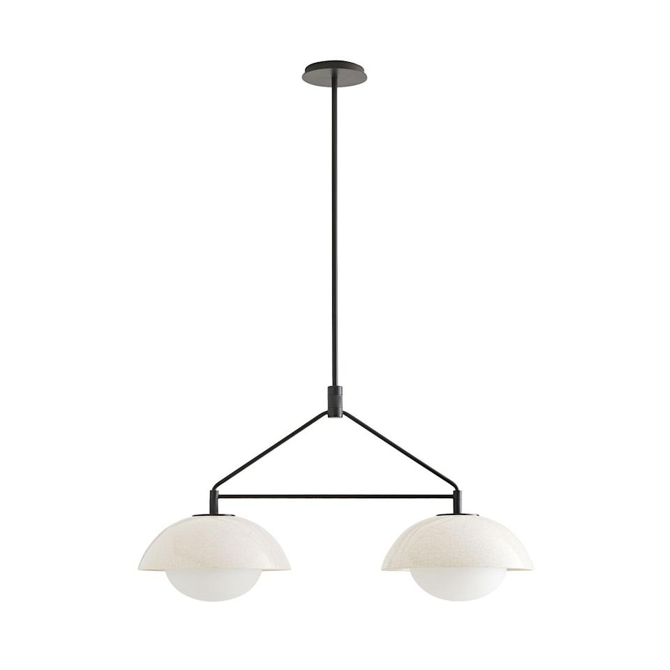 """<p><strong>Workshop/APD</strong></p><p>arteriorshome.com</p><p><strong>$1040.00</strong></p><p><a href=""""https://www.arteriorshome.com/glaze-linear-pendant-da49001"""" rel=""""nofollow noopener"""" target=""""_blank"""" data-ylk=""""slk:Shop Now"""" class=""""link rapid-noclick-resp"""">Shop Now</a></p><p>This pendant certainly stands on its own, but hung in multiples, makes a seriously stylish statement.</p>"""