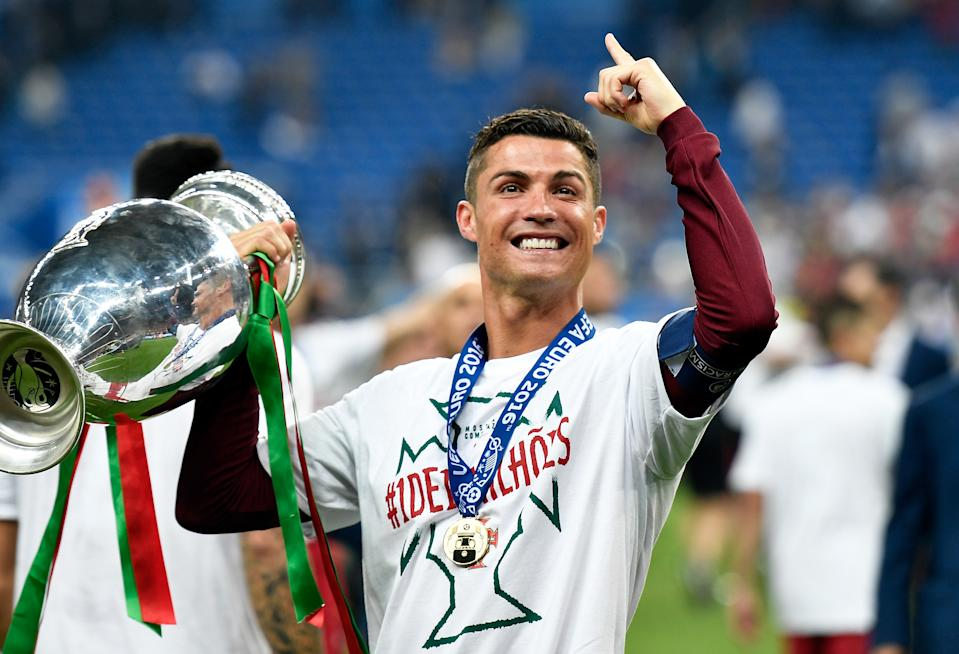 Portugal's Cristiano Ronaldo holds the trophy  after winning the Euro 2016 final soccer match between Portugal and France at the Stade de France in Saint-Denis, north of Paris, Sunday, July 10, 2016. Portugal won 1-0. (AP Photo/Martin Meissner)
