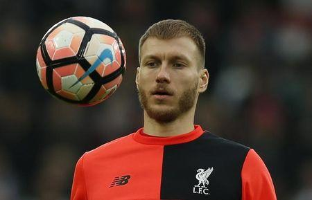 Liverpool's Ragnar Klavan warms up before the match