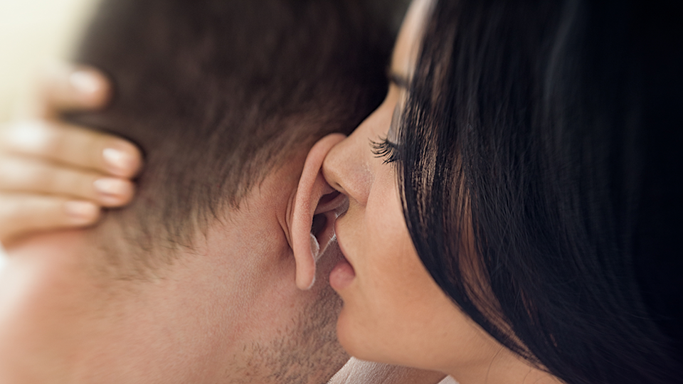 Woman sexy whispers to man representing 2020's sex slang