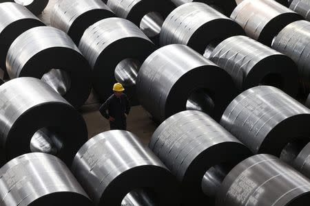 File photo of an employee working at a steel factory that exports to Europe and America in Jiaxing