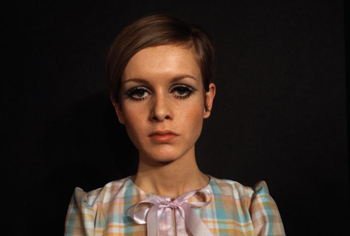 Photo of model Twiggy in a plaid shirt
