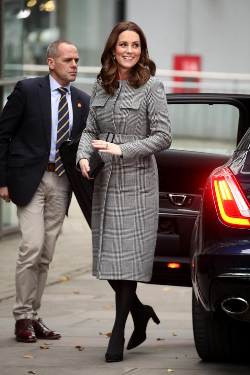 Kate Middleton stunned in this $870 belted coat the Children's Global Media Summit. Photo: Getty Images