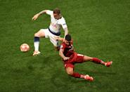 Tottenham Hotspur's Kieran Trippier and Liverpool's Roberto Firmino in a tangle. (Photo by Joe Giddens/PA Images via Getty Images)