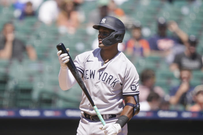 New York Yankees' Miguel Andujar walks to the dugout after striking out during the fourth inning of a baseball game against the Detroit Tigers, Sunday, May 30, 2021, in Detroit. (AP Photo/Carlos Osorio)